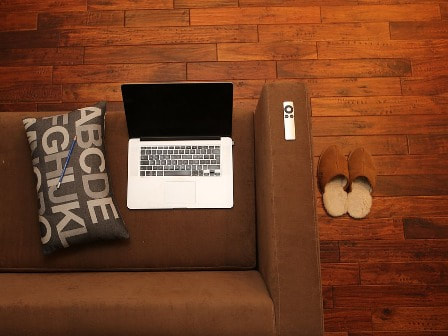 Brown sofa and laptop